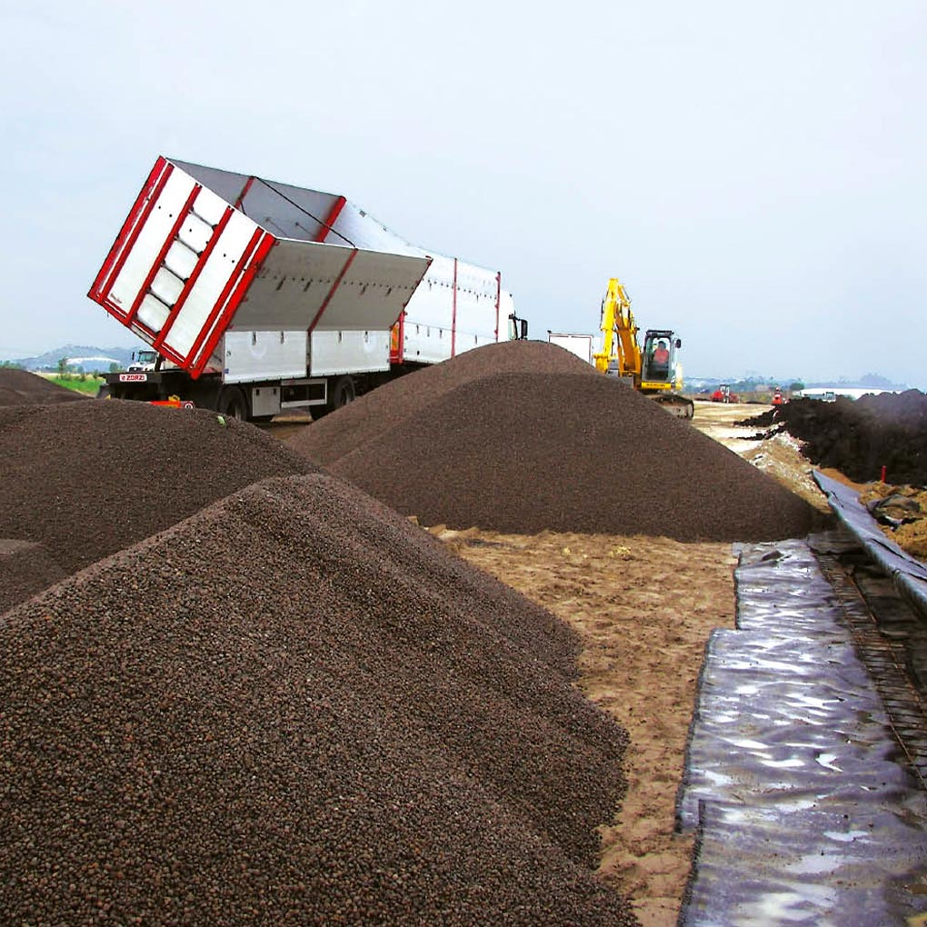 Embankments constructed over landfill material